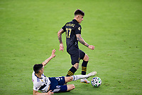 LOS ANGELES, CA - SEPTEMBER 23: Cristian Gutierrez #3 of the Vancouver Whitecaps attempts a tackle on Brian Rodriguez #17 of LAFC during a game between Vancouver Whitecaps and Los Angeles FC at Banc of California Stadium on September 23, 2020 in Los Angeles, California.