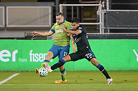 SAN JOSE, CA - OCTOBER 18: Jordan Morris #13 of the Seattle Sounders is marked by Andy Rios #25 of the San Jose Earthquakes during a game between Seattle Sounders FC and San Jose Earthquakes at Earthquakes Stadium on October 18, 2020 in San Jose, California.