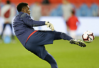 TORONTO, ON - OCTOBER 15: Sean Johnson #12 of the United States warms up during a game between Canada and USMNT at BMO Field on October 15, 2019 in Toronto, Canada.