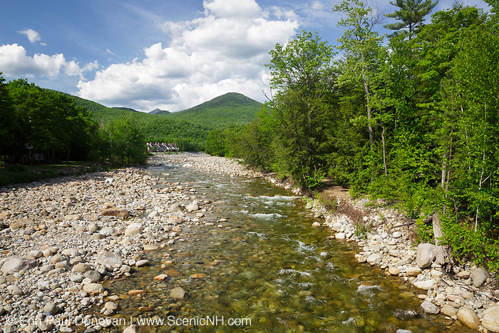 Big Coolidge Mountain from the Richard F. Cooper Memorial Bridge in Lincoln, New Hampshire during the spring months. The Richard F. Cooper Memorial Bridge crosses the East Branch of the Pemigewasset River.