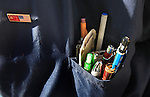 A pocket full of pins and pencils worn by Jackson who shines shoes near market Street and Turk in the tenderloin district of San Francisco, California.