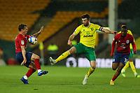 6th April 2021; Carrow Road, Norwich, Norfolk, England, English Football League Championship Football, Norwich versus Huddersfield Town; Grant Hanley of Norwich City challenges Jonathan Hogg of Huddersfield Town
