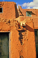 Wooden water gutter showing damage from run off, Taos Pueblo, New Mexico