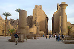 In the Great Court of the Temple of Amun.The remains of the Kiosk of Taharka who ruled Egypt from 690-664 BC.The gateway to the Hypostyle Hall in the second pylon is flanked by colosuss statues of Ramses II. The second pylon was began by Horemheb who ruled Egypt from 1319-1292 BC, continued by Ramses I who ruled from 1292-1290 BC or 1295-1294 BC and Ramses II who ruled from 1279 -1213 BC and finally added to in the Ptolemaic Period 332-30 BC. Karnak is part of the ancient city of Thebes ( built in and around modern day Luxor).The building of the Temple complex at Karnak began in the reign of the Pharaoh Senusret I who ruled Egypt from 1971-1926 BC. Approximately 30 Pharaohs contributed to the building of the complex and in so doing made it the largest ancient religious site in the world. The ancient name for Karnak was Ipet-isut (Most select of places).