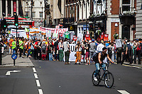 """London, 08/05/2016. Today, """"Campaign Against Climate Change"""" held a demonstration to protest against the policies of the British Conservative Government in tackling climate change and to accuse it of not supporting enough clean energy technology. Then protesters, activist and members of the public marched backward from Trafalgar Square to the Department of Energy and Climate Change, Downing Street, Department of Health (Opposite the Treasury). From the organisers Facebook page: <<No more UK backtracking on climate! Since May 2015 clean energy technology has been sidelined in favour of a dash for gas, insulation cut and fracking, roads and runways pushed through despite strong local opposition. So what better way to mark the government's one year anniversary than to march - backwards - down Whitehall? A creative and colourful protest that will make a serious point: we're running out of time to act on climate change, and we can't afford to go backwards. […]>>. The demonstration was supported by: Art Not Oil, Biofuelwatch, Campaign for Better Transport, Client Earth, Climate Revolution, Fuel Poverty Action Group, Global Justice Now, Greenpeace, HACAN, Plane Stupid, Reclaim the Power, Solar Trade Association, Talk Fracking, Time to Cycle, War on Want, The Truth about Zane.<br /> <br /> For more information please click here: https://www.facebook.com/events/1694984727439786/?active_tab=highlights & http://www.campaigncc.org/goingbackwards"""