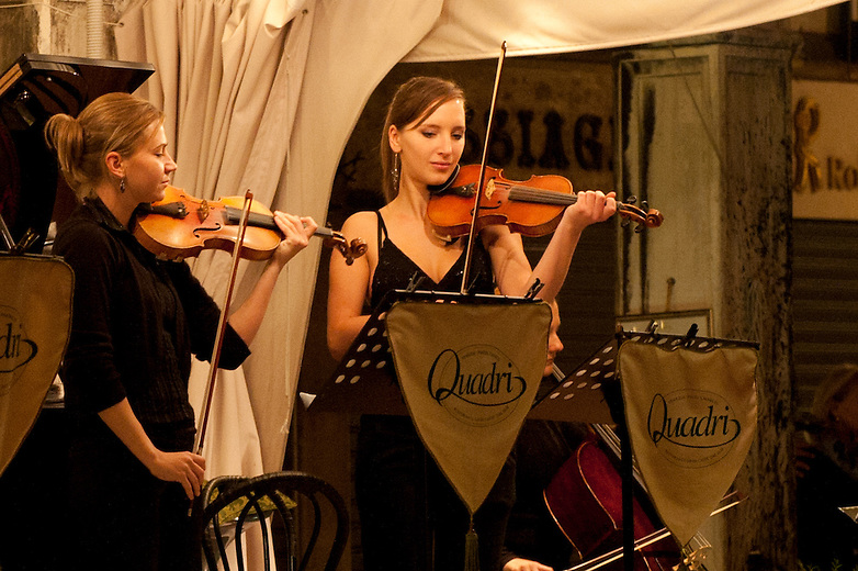 Professional musicians entertain visitors and locals at the historical cafes located in St Mark's Square. Most of the cafés were established in the eighteenth century, when Venice was still an independent state and a famous mercantile port of call. Contracts and agreements between merchants were signed in the private indoor spaces of these cafés.