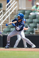 Carlos Herrera (2) of the Asheville Tourists squares to bunt against the Kannapolis Intimidators at Kannapolis Intimidators Stadium on May 7, 2017 in Kannapolis, North Carolina.  The Tourists defeated the Intimidators 4-1.  (Brian Westerholt/Four Seam Images)