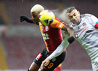 15th March 2020, Istanbul, Turkey;  Burak Yilmaz of Besiktas explodes water from the ball as he wins the heder from Mario Lemina of Galatasaray during the Turkish Super league football match between Galatasaray and Besiktas at Turk Telkom Stadium in Istanbul , Turkey on March 15 , 2020.