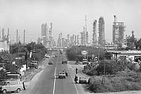 Sicily, State road SS 114 Orientale Sicula at the Priolo and Melilli petrochemical plants (April 1980)<br /> <br /> - Sicilia, strada statale SS 114 Orientale Sicula  all'altezza degli impianti petrolchimici di Priolo e Melilli (aprile 1980)