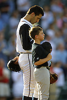 Houston Astros pitcher Andy Pettitte (37) during the National Anthem before his first rehab start with the Round Rock Express of the Texas League on June 18, 2004 at the Dell Diamond in Round Rock, Texas. (Andrew Woolley/Four Seam Images)