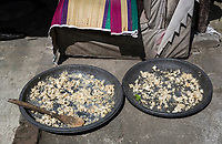 Yogyakarta, Java, Indonesia.  Drying Previously-cooked Rice.  It will be reecycled as leftovers for eating at the next meal.