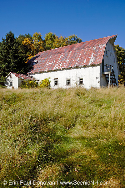 Barn with red metal roof at the Daniel Webster Birthplace site in Franklin, New Hampshire during the autumn months.