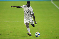 WASHINGTON, DC - NOVEMBER 8: Kizza Mustafa #12 of Montreal Impact moves the ball during a game between Montreal Impact and D.C. United at Audi Field on November 8, 2020 in Washington, DC.