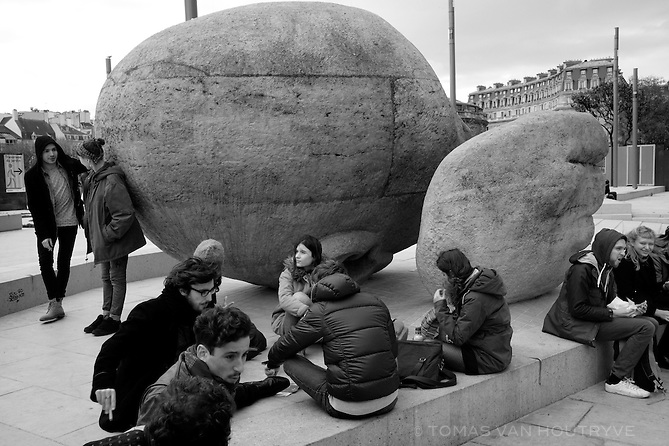 Young Parisians gather near the Ecoute sculpture near Saint Eustache in Paris, France three days after coordinated terrorist attacks struck the heart of the French capital.