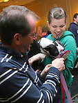SOUTHBURY,  CT.- 19 MARCH  2011 031911JW01- Bob DeJoseph with daughter Corinne Dejoseph show their Boston Terrier Sadie the award that she received for being in the rescued dogs parade Saturday afternoon during the Boston Terrier Club annaul show at the Crown Plaza Hotel.<br /> Jonathan Wilcox Republican American