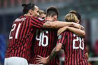 Hakan Calhanoglu of AC Milan (R) celebrates with team mates after scoring the goal of 1-0 during the Serie A football match between AC Milan and Atalanta BC at stadio Giuseppe Meazza in Milano ( Italy ), July 24th, 2020. Play resumes behind closed doors following the outbreak of the coronavirus disease. <br /> Photo Image Sport / Insidefoto