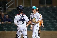 Salt River Rafters starting pitcher Nick Neidert (15) and catcher Ben Rortvedt (3) during an Arizona Fall League game against the Naranjeros de Hermosillo on September 24, 2019 at Salt River Fields at Talking Stick in Phoenix, Arizona. Salt River defeated Hermosillo 4-1. The Naranjeros, of the Mexican Pacific League, played in Scottsdale as part of the Mexican baseball Fiesta. (Zachary Lucy/Four Seam Images)