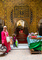 Fes, Morocco.  Entrance to the Zaouia of Moulay Idris II.  Candles for Sale.