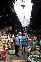 People walk through the Kolay market in central Kolkata.<br /> <br /> To license this image, please contact the National Geographic Creative Collection:<br /> <br /> Image ID: 1925828 <br />  <br /> Email: natgeocreative@ngs.org<br /> <br /> Telephone: 202 857 7537 / Toll Free 800 434 2244<br /> <br /> National Geographic Creative<br /> 1145 17th St NW, Washington DC 20036
