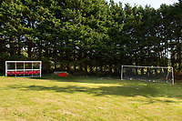 """COPY BY TOM BEDFORD<br />Pictured: The dug out in the back garden of Matt Evans in south Wales, UK<br />Re: A soccer-mad lottery millionaire has splashed out on his own football pitch complete with a dug-out on the touchline.<br />Former postman Matt Evans 37, turned his back garden into a mini soccer stadium so his mates can come for a kick about.<br />The super-rich bachelor is blowing his fortune on his love for the beautiful game.<br />He said: """"I'm living the dream by having my own pitch with lifesize goals and all the white markings.<br />""""I invite my old workmates around for a game and we sit in the dugout to talk about football.<br />""""My dad comes along for a game but we usually ask him to play in goal.""""<br />Matt was a £300-a-week postman three years ago using jumpers for goalposts in his local park.<br />But after a lottery lucky dip netted him £2,604,015 he's living the life of a Premiership soccer star."""