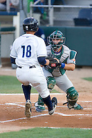 August 6, 2010: Boise Hawks catcher Micah Gibbs (#33) blocks home plate during a Northwest League game against the Everett AquaSox at Everett Memorial Stadium in Everett, Washington.