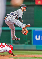 30 August 2015: Miami Marlins infielder Adeiny Hechavarria turns a double play in the 4th inning against the Washington Nationals at Nationals Park in Washington, DC. The Nationals rallied to defeat the Marlins 7-4 in the third game of their 3-game weekend series. Mandatory Credit: Ed Wolfstein Photo *** RAW (NEF) Image File Available ***