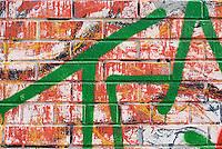 Graffiti on a Brick Wall  in New York City's Chinatown