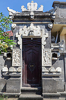 Jimbaran, Bali, Indonesia.  Doorway Entrance to a House, with Stone Decorations.