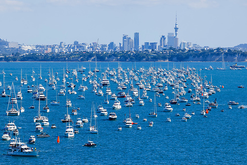 Race Day 3 and spectator boats watch the action in Auckland Harbour during the 36th America's Cup in March 2021