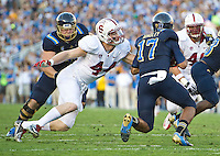 PASADENA, CA - November 24, 2012:  Stanford linebacker Chase Thomas (44) pressures the UCLA quarterback during the Stanford Cardinal vs the UCLA Bruins at the Rose Bowl in Pasadena, CA. Final score Stanford Cardinal 34, UCLA Bruins 17.
