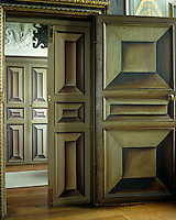 Double doors opening from the Long Gallery at Powis Castle have been painted in a trompe l'oeil 3D effect