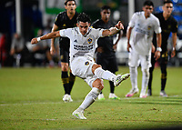 LAKE BUENA VISTA, FL - JULY 18: Cristian Pavón #10 of LA Galaxy follows through on a penalty shot during a game between Los Angeles Galaxy and Los Angeles FC at ESPN Wide World of Sports on July 18, 2020 in Lake Buena Vista, Florida.