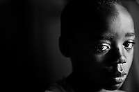 A boy orphaned by AIDS in his grandmother's house in Kampala, Uganda on April 20, 2001. More than 13 million African children have been orphaned by the the AIDS pandemic. Worldwide, more than 20 million people have died since the first cases of AIDS were identified in 1981.