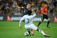 James TROISI (11) of Australia and Kamel AL MOUSA (7) of Saudi Arabia fight for the ball during the FIFA 2014 World Cup Group D Asian Qualifier match between Australia and Saudi Arabia at AAMI Park in Melbourne, Australia...This image is not for sale on this web site. Please contact Southcreek Global Media for licensing:.Toll Free: 1.800.934.5030.Canada: 701 Rossland Rd. East, Suite 315, Whitby, Ontario, Canada, L1N 9K3.USA: 10792 Baron Dr, Parma OH, USA 44130.Web: http://southcreekglobal.net/ and http://southcreekglobal.com/