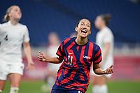 SAITAMA, JAPAN - JULY 24: Christen Press #11 of the United States celebrates a goal during a game between New Zealand and USWNT at Saitama Stadium on July 24, 2021 in Saitama, Japan.