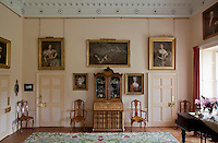 Different generations of female members of the Munro family displayed on the drawing room wall