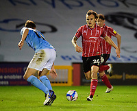Lincoln City's Harry Anderson runs at Manchester City U21's Callum Doyle<br /> <br /> Photographer Andrew Vaughan/CameraSport<br /> <br /> EFL Papa John's Trophy - Northern Section - Group E - Lincoln City v Manchester City U21 - Tuesday 17th November 2020 - LNER Stadium - Lincoln<br />  <br /> World Copyright © 2020 CameraSport. All rights reserved. 43 Linden Ave. Countesthorpe. Leicester. England. LE8 5PG - Tel: +44 (0) 116 277 4147 - admin@camerasport.com - www.camerasport.com