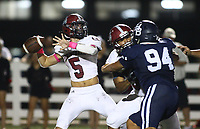 Landon Phipps (5) of Springdale passes ball on Friday, Oct. 8, 2021, during the first half of play at Wildcat Stadium in Springdale. Visit nwaonline.com/211009Daily/ for today's photo gallery.<br /> (Special to the NWA Democrat-Gazette/David Beach)