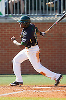 Desmond Roberts (26) of the Charlotte 49ers follows through on his swing against the Canisius Golden Griffins at Hayes Stadium on February 23, 2014 in Charlotte, North Carolina.  The Golden Griffins defeated the 49ers 10-1.  (Brian Westerholt/Four Seam Images)