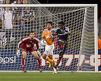 Houston Dynamo forward Brian Ching (25) and New England Revolution defender Emmanuel Osei (5) battle on a corner kick. The New England Revolution defeated Houston Dynamo, 1-0, at Gillette Stadium on August 14, 2010.