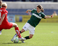 Chicago Red Star forward Karen Carney (14) attempts to maneuver past Washington Freedom midfielder Allie Long (9).  The Washington Freedom defeated the Chicago Red Stars 3-2 at Toyota Park in Bridgeview, IL on July 26, 2009.