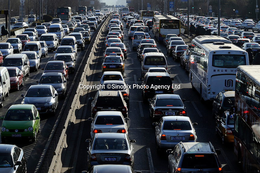 Congested traffic on Beijing motorway, China. Traffic congestion is a prominent problem in Beijing with automobiles increasing by 10 percent annually and roads being extended by only 2 percent.  Beijing's traffic problem will only get worse since people's incomes increase while prices of automobiles decrease..09 Mar 2011