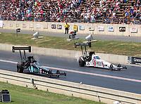 Jul 22, 2018; Morrison, CO, USA; NHRA top fuel driver Scott Palmer (left) alongside Antron Brown during the Mile High Nationals at Bandimere Speedway. Mandatory Credit: Mark J. Rebilas-USA TODAY Sports