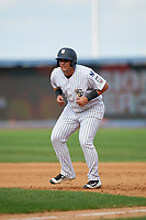 Staten Island Yankees designated hitter Miguel Flames (60) leads off first base during a game against the Lowell Spinners on August 22, 2018 at Richmond County Bank Ballpark in Staten Island, New York.  Staten Island defeated Lowell 10-4.  (Mike Janes/Four Seam Images)