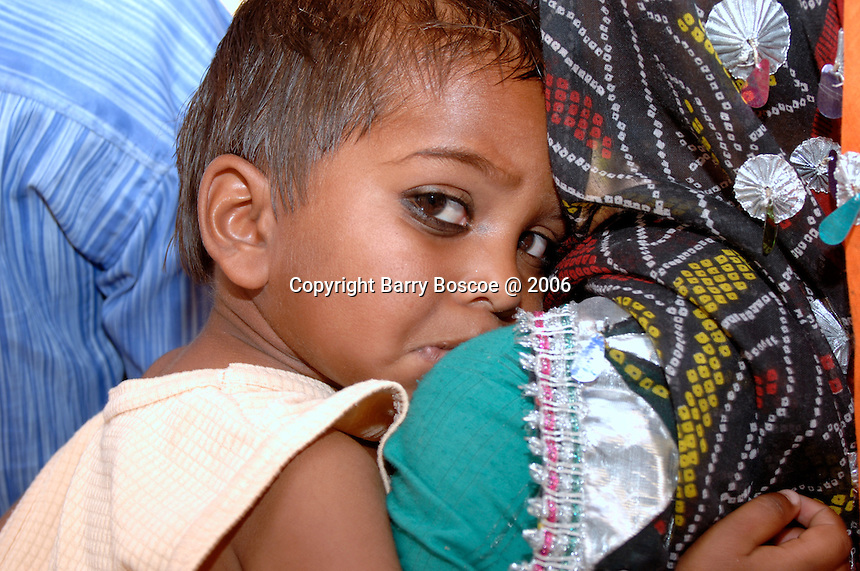Portrait of young girl with her mother in Rajasthan, India