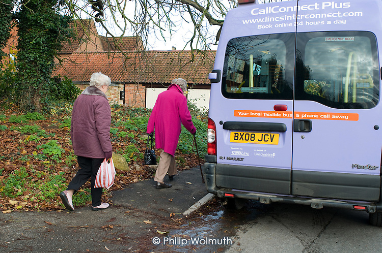 "Two elderly women board a CallConnect bus in the village of Ewerby, Lincolnshire.  The innovative bus-on-demand service features in the Rural Media Company's ""Over the Hill?"" project."