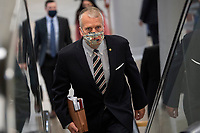 "UNITED STATES - February 9: Sen. Dan Sullivan, R-Alaska, walks through the Senate subway on the first day of former President Donald Trump's second impeachment trial at the U.S. Capitol in Washington on Tuesday, Feb. 9, 2021. Trump is charged with ""incitement of insurrection"" after his supporters stormed the Capitol in an attempt to overturn November's election result.<br /> CAP/MPI/RS<br /> ©RS/MPI/Capital Pictures"