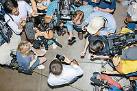 Media surround South Bend mayor and Democratic presidential candidate Pete Buttigieg as he takes a selfie with the Butter Cow at the Iowa State Fair in Des Moines, Iowa, on Tues., Aug. 13, 2019.