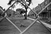 New Orleans, Louisiana.USA.July 28, 2006..High fencing surrounds a housing project in central New Orleans keeping it closed to former residents nearly one year after hurricane Katrina hit and the levees broke leaving 80% of the city flooded...