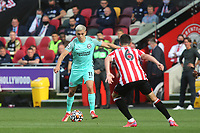 Leandro Trossard of Brighton & Hove Albion takes on Brentford's Christian Norgaard during Brentford vs Brighton & Hove Albion, Premier League Football at the Brentford Community Stadium on 11th September 2021